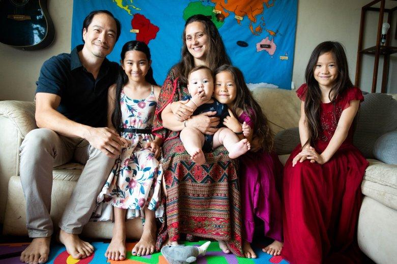 Tameka Issartel poses with her husband Yukio Hoshi and their children Kalea, 10, Tenshin, 7 months, Nalani, 5, and Luana, 7, in their El Sereno living room on Thursday, September 9, 2021 where she birthed Tenshin. Midwife Racha Tahani Lawler pulled off her N95 and performed CPR all the way to the hospital after Tenshin struggled to take his first breath. (Photo by Sarah Reingewirtz, Los Angeles Daily News/SCNG)