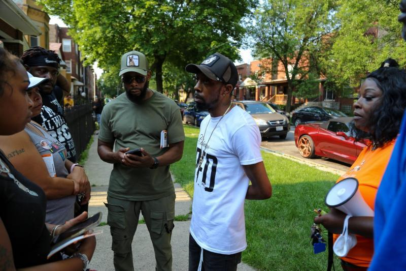 Chicago CRED street outreach workers canvas the Pullman and Roseland neighborhoods on a recent Saturday. Former U.S. Secretary of Education Arne Duncan launched the group after a historic spike in gun violence in 2016. Olivia Obineme for The Trace