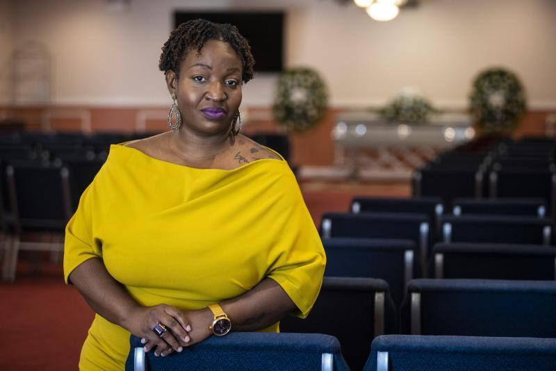 Nhemya Ward, a funeral director at Johnson's Funeral Home at in Austin, inside the West Side funeral home. Ashlee Rezin Garcia / Sun-Times