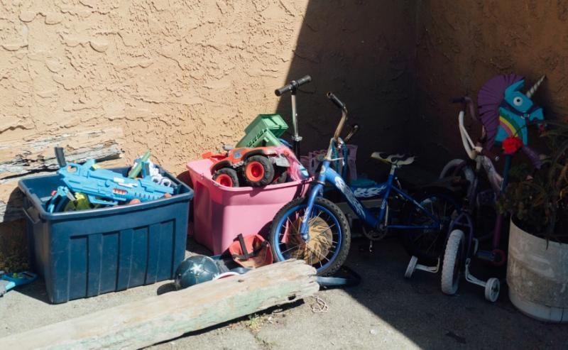 Toys are gathered in the courtyard for children who live in the complex. (AL KAMALIZAD/LAIST)