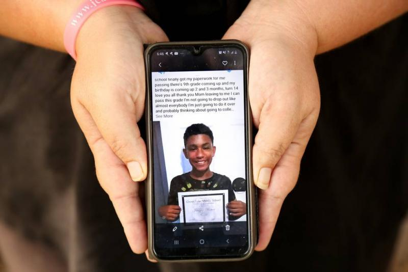 Winters shows a photo of her son, Jahheen, graduating middle school. DOUGLAS R. CLIFFORD | Times