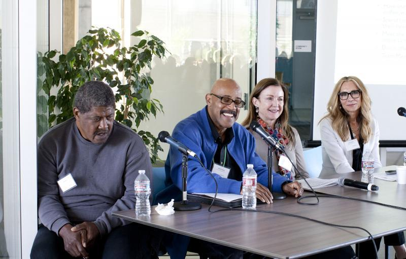 Case manager Maurice Gray of Exodus Recovery, second from left, speaks to journalists at Star Apartments. He's joined by formerly homeless resident Joe Sims, nurse practitioner Nancy Richardson of Exodus, and Lezlie Murch, senior vice president of programs at Exodus, far right.