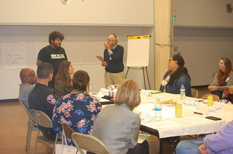 Steve Mencher and Edgar Avila lead a discussion at a community meeting to identify reporting topics.