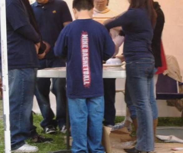 Youth place bets at a gambling booth.