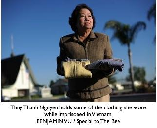 Thuy Thanh Nguyen holds some of the clothing she wore while imprisoned in Vietnam.