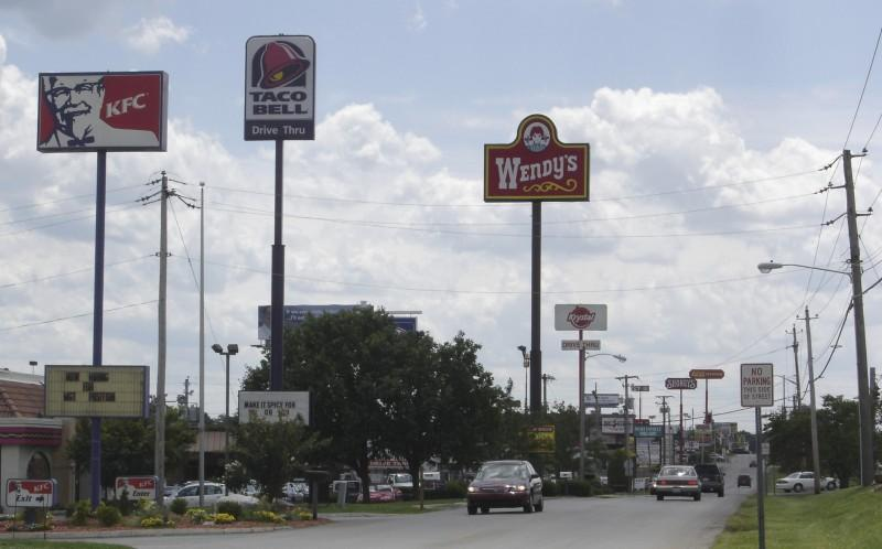 Picture of a highway in which fast food ads are featured:KFC, Wendy's and Taco Bell among others. Taken in Bowling Green, KY.