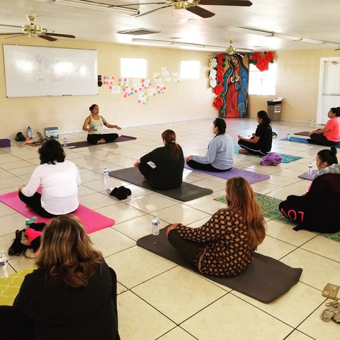 Dulce Juarez offers free yoga classes in Spanish at PUENTE Movement circa 2018,  to create healing spaces for immigrant communities. (Photo by Francisca Porchas, Healing in Resistance)