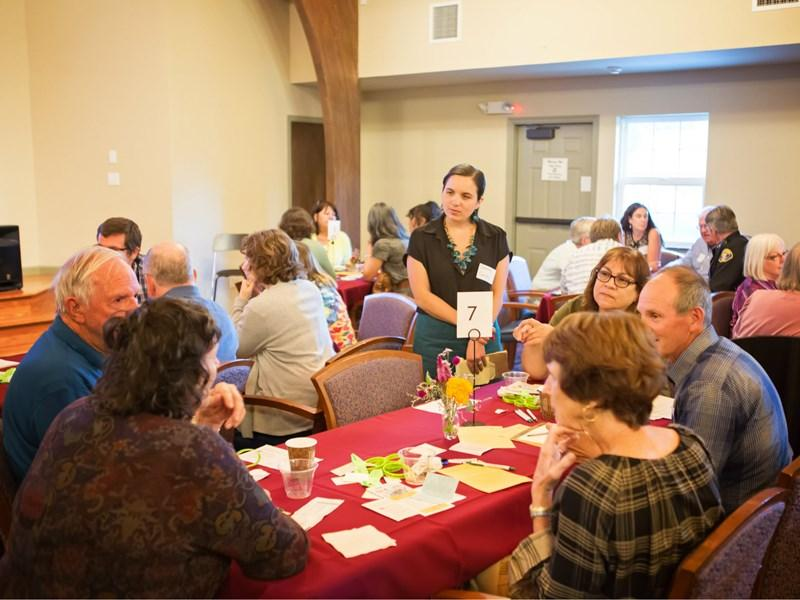 CapRadio reporter Sammy Caiola listens in as attendees discuss how to prevent suicide in Amador County. Vanessa S. Nelson / Capital Public Radio
