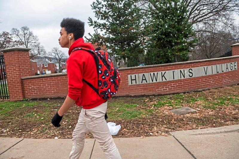 Jared Todd walks home from school after getting off the bus at Hawkins Village in Rankin. Todd's daily routine includes coming straight home and playing video games, drawing — cartoon characters, hands, flowers, things he sees on YouTube — or writing poems.