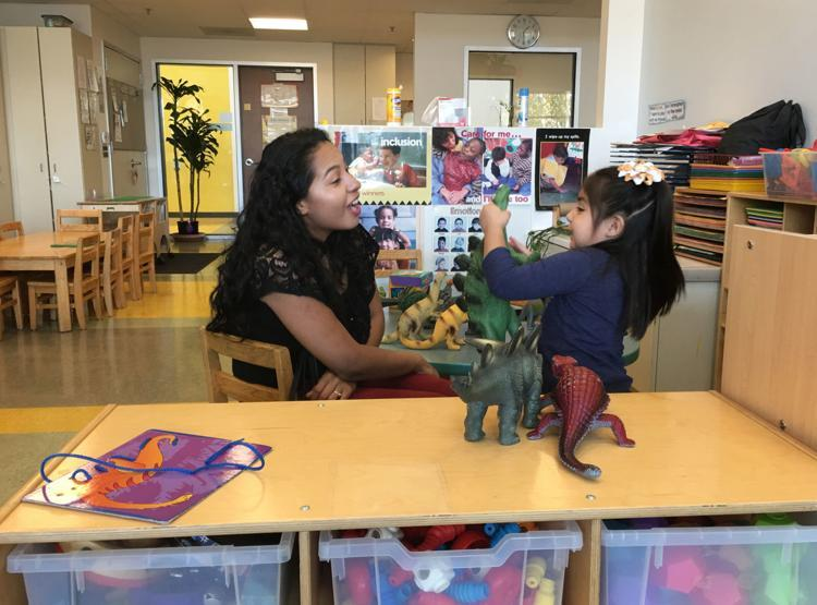 The Magnolia Place collaborative in Los Angeles identified four areas needed to create a safe environment in which children can be free of abuse: educational success, good health, economic stability, and safe and nurturing parenting. Above, Joshi Zamudio and daughter Aylin Ramirez, 3, play during a family enrichment program at Magnolia Place.