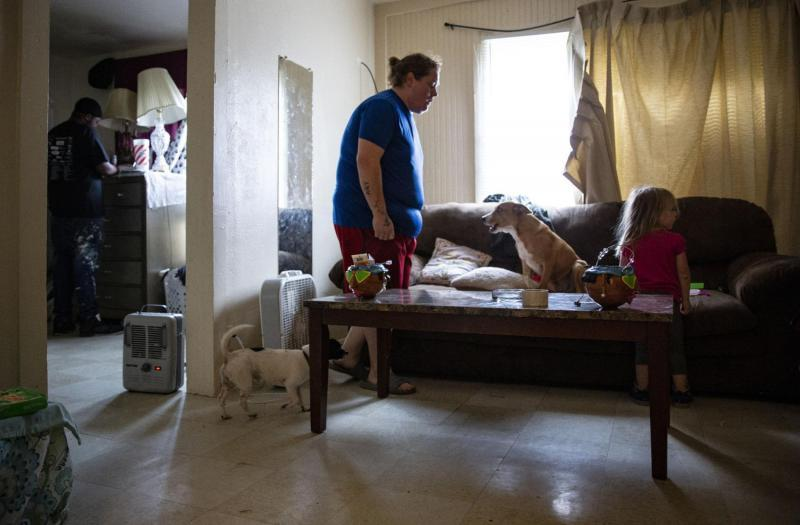 Locked out of their apartment, Johnson, Gary, Lirik and their two dogs take refuge from chilly weather in a neighbor's apartment during the day. Uncertain of where they will sleep at night, Gary sent her daughter to spend the night with her mother.