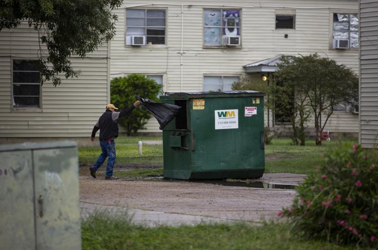 A Crossroads maintenance worker throws a black garbage bag filled with items he collected from Gary and Johnson's apartment into a dumpster. The bag was one of several that ended up in the garbage. Without giving Gary an exact time, the crew let themselves into her apartment and cleared all of the family's belongings out in about an hour.