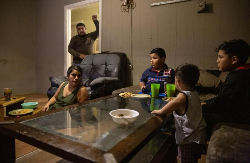 Sanchez Salas asks the family if they need more tortillas during dinner. Barrientes sits on the floor and uses steps as a table while Jonathan, Fernando and Nathan eat off the coffee table. Barrientes said typically she eats on the coffee table and Nathan sits on the steps.