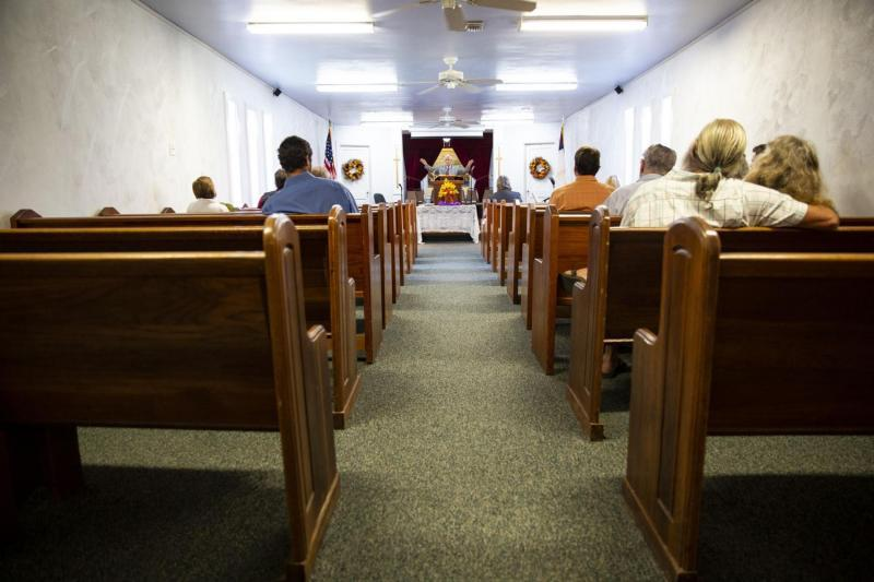 The Rev. Bill Lindsey preaches to a small congregation of about 20 at First Baptist Church. Before Hurricane Harvey, the modest church had around 35 parishioners. It is the only operational place of worship in town after Harvey's devastation.