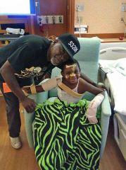 """Erik """"Doobie"""" Williams Jr. and Andre Lee Ellis take a picture in the hospital after the 4-year-old came out of a coma after he was was shot four times near North 10th and West Burleigh streets on Aug. 10. (Photo: Photo courtesy of Andre Lee Ellis)"""