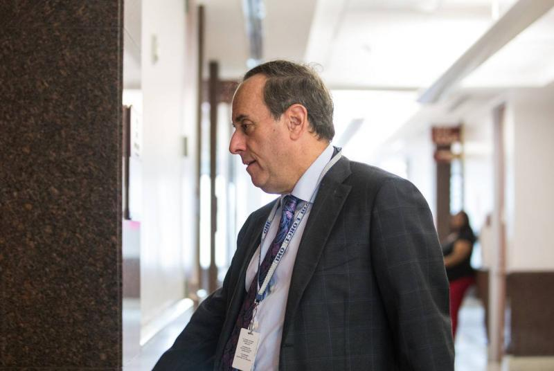 Attorney Gary Polland enters a courtroom at the Harris County Juvenile Justice Center. Polland takes a high number of court appointments and is also involved in local politics.  Pu Ying Huang for The Texas Tribune