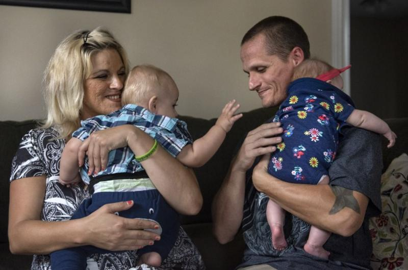 Cheyenne Easter and Jeremy Jones with Sebastian, 13 months and Charlotte, 3 months, spent years living on the streets addicted to drugs and alcohol. They journeyed into the legal system and eventually into sobriety. They are hoping to be awarded full custody of their children early next year. (Photo by Mindy Schauer, Orange County Register/SCNG)