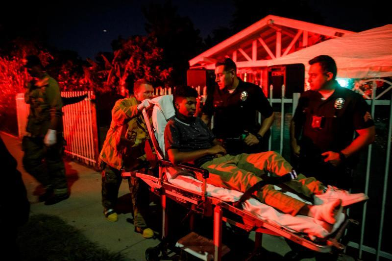 LAPD officers and first responders answer a call from local residents about a boy shot in the foot.