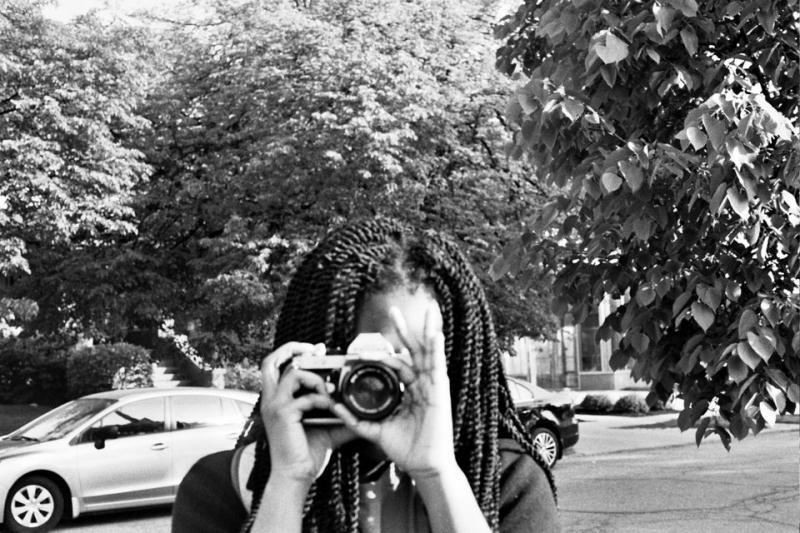 Adora Ezepue, 15, practices with her 35 mm film camera in University Circle. Photo by Isadora Waller