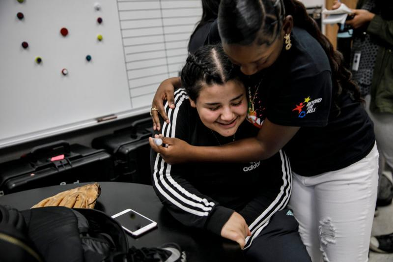 Jaleyah Collier hugs her friend Shelsea Reyes, 17.