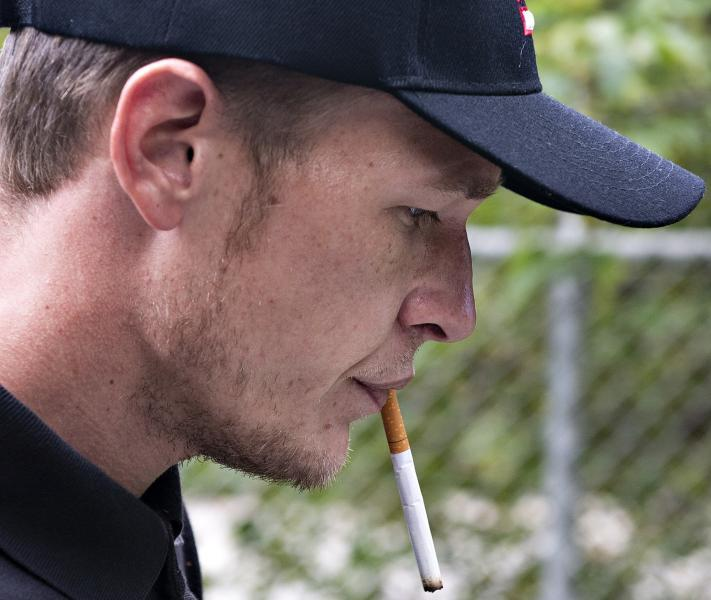 Travis Litts smokes a cigarette on a walk in Lansford. Rick Kintzel / The Morning Call