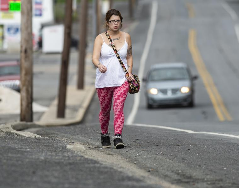 Alicia Kachmar of Lansford walks along Route 209 in Coaldale to go to nearest emergency room at St. Luke's Miners Campus to seek treatment for a toothache. Rick Kintzel / The Morning Call