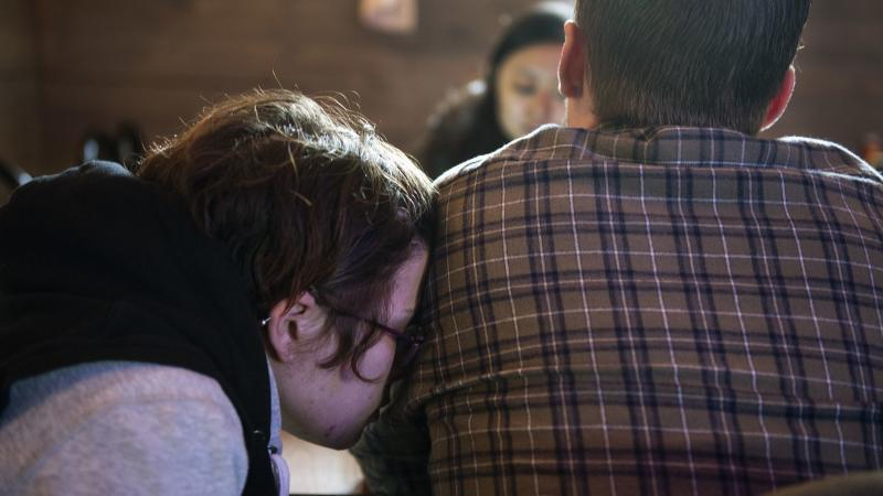 Alicia Kachmar places her head on the shoulder of her fiancée Travis Litts while eating lunch at the Coal Miners Bar & Grill in Lansford. Rick Kintzel / The Morning Call