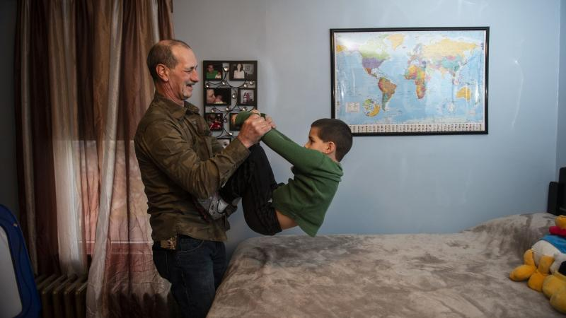 Jon Steigerwalt plays with his 7-year-old grandson Reese in the same room that was his daughter's at Kay's Palmerton home. (Photo Credit: Rick Kintzel/The Morning Call)