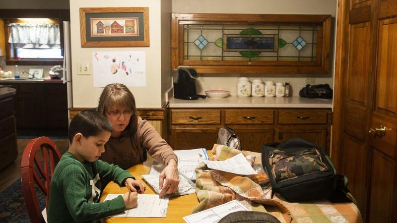 Kay Steigerwalt sits with her grandson Reese as he works on his homework. Rick Kintzel / The Morning Call