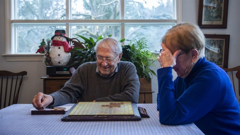 Milton Stemler, 95, smiles as he grabs another letter while playing Scrabble with his wife Jeanne, 91, in their Lower Towamensing Township home. The couple play the game on a daily basis. Rick Kintzel / The Morning Call