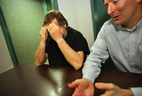 Butch Kimmerling buries his head in his hands while talking about the molestation of his adopted daughter, Ashley. Attorney John Erickson III sits nearby. (INDYSTAR FILE IMAGE)