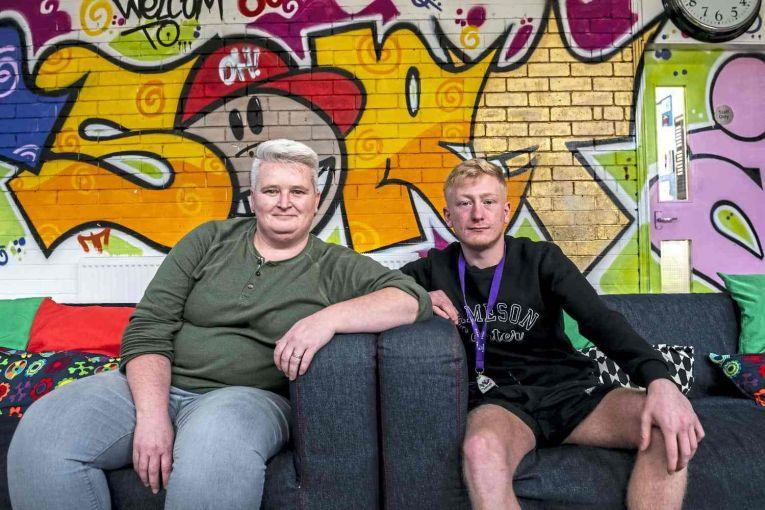 Gillian Kirkwood, Y Sort It coordinator, left, and Jason Smith, a youth worker with Y Sort It, sit in the organization's lounge in Clydebank. Image by Michael Santiago. United Kingdom, 2019.