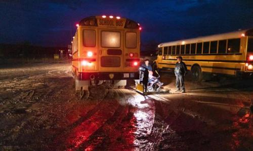 Parents are forced to drop their children at the Sanostee chapter house because the buses are unable to navigate the muddy roads. Photograph: Don J Usner/Searchlight New Mexico