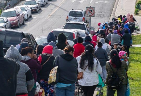 A line of Salinas residents await their chance to get food benefits from members of The Celebration Church. The members offer clothes, eggs, canned food and restroom supplies on Jan. 18, 2020.  (Photo: David Rodriguez/The Salinas Californian)