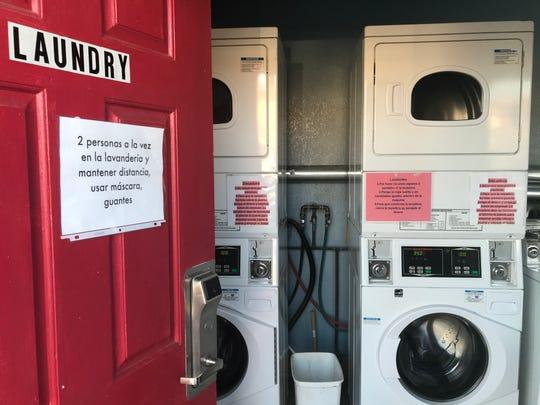 A sign on the laundry room door cautions motel H-2A guests that only two can occupy the room at a time. April 13, 2020. (Photo: Kate Cimini / The Salinas Californian)