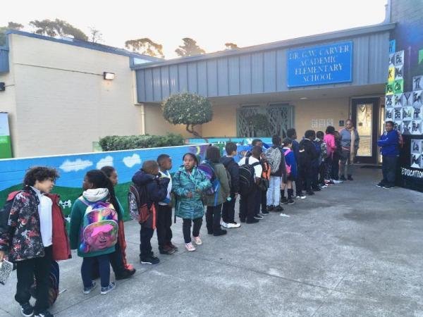 Carver Elementary students line up to begin the school day at the campus in San Francisco's Bayview district. (CREDIT LEE ROMNEY / KALW)