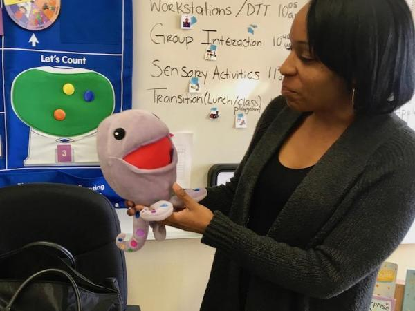 "Shoestrings program coordinator Crystal Hawkins shows off ""Huggtopus,"" a plush toy in the Kimochis series. Kimochis (which means ""feelings"" in Japanese) come with a curriculum to help kids better deal with difficult feelings and challenging behaviors. (CREDIT LEE ROMNEY / KALW)"