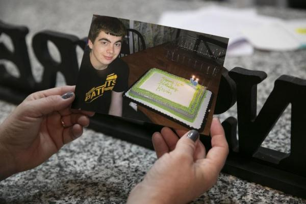 HEATHER KHALIFA / STAFF PHOTOGRAPHER Joanne Endrick holds a photo of her son Kevin celebrating his 16th birthday.