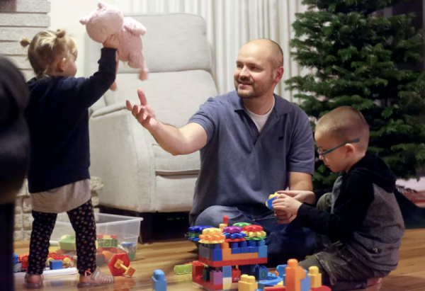 Dustin Wallis, a nonsmoker who has stage 4 lung cancer, plays with his children Annabelle and James at home in Cottonwood Heights, Utah, on Tuesday, Dec. 3, 2019. Kristin Murphy, Deseret News