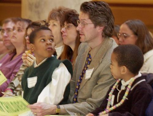 Craig Peterson, alongside his sons, Michael (right), 6, and Andrew, 7, attend a rally for children's issues at the Indiana State Capitol in 2001. (INDYSTAR FILE IMAGE)