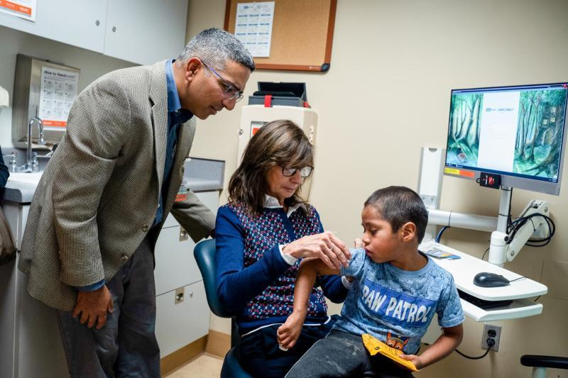 Six-year-old Abraham Gonzalez-Martinez at a checkup at UCLA in November 2019 along with clinicians Maria Garcia-Lloret (center) and Manish Butte (left). Read and listen to Kerry Klein's feature story following Abraham's treatment on KVPR Valley Public Radio. Credit: Nick Carranza/UCLA Health