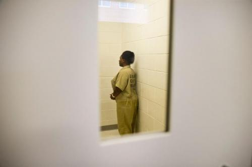 Ashley Peterson makes her way back to her cell inside the Douglas County Jail in Douglasville, Georgia. (MYKAL MCELDOWNEY/INDYSTAR)