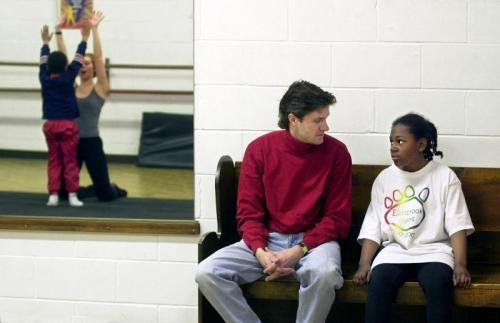 Ashley and her adoptive father Craig Peterson chat during a break in a dance class. (INDYSTAR FILE PHOTO)