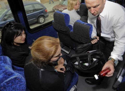 Daniel Hancz, Pharmacist and Investigator for the Los Angeles County Department of Public Health, right, shows Fellows a confiscated medical bag from an unlicensed physician used to make house calls.