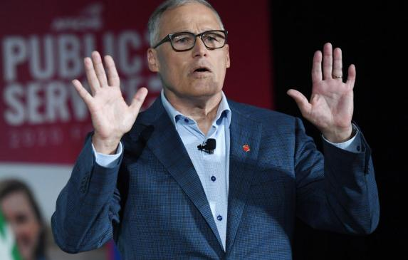 "Washington Gov. Jay Inslee has been critical of his neighbors. ""One of the reasons we have such jammed up hospitals in Spokane i"