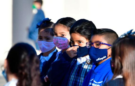 A student adjusts her facemask at St. Joseph Catholic School in La Puente, California in November 2020