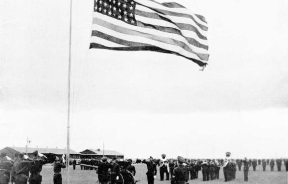 Sailors saluting flag at Lemoore, black and white.