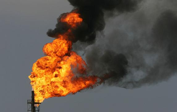 Flames rise in a burn-off of toxic gases at an oil refinery in Wilmington in 2005.