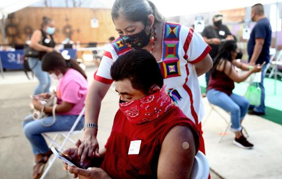 A mobile clinic vaccinates Central American Indigenous residents in Los Angeles in April.