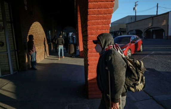 People walk into downtown Calexico after crossing the United States-Mexico border on December 1, 2020.